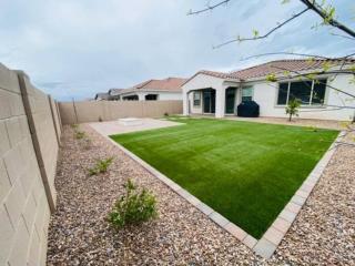 Artificial Grass – Back Yard – Hot Tub Area with Pavers – Landscape Rock – Yard Stylist – Eastmark AZ