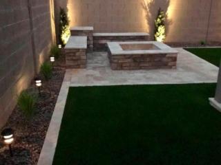 Fire Pit – Travertine Pavers – Artificial Grass – Accent Lighting – Yard Stylist – Arizona