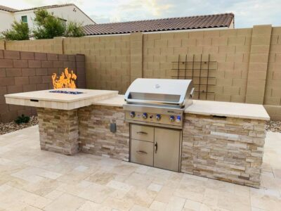 Outdoor Kitchen - Travertine Pavers - Fire Pit on Bar and Grill - Yard Stylist - Cadence at Gateway AZ